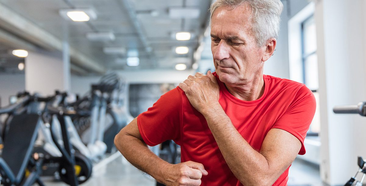 A man practicing physical therapy after total shoulder replacement surgery.