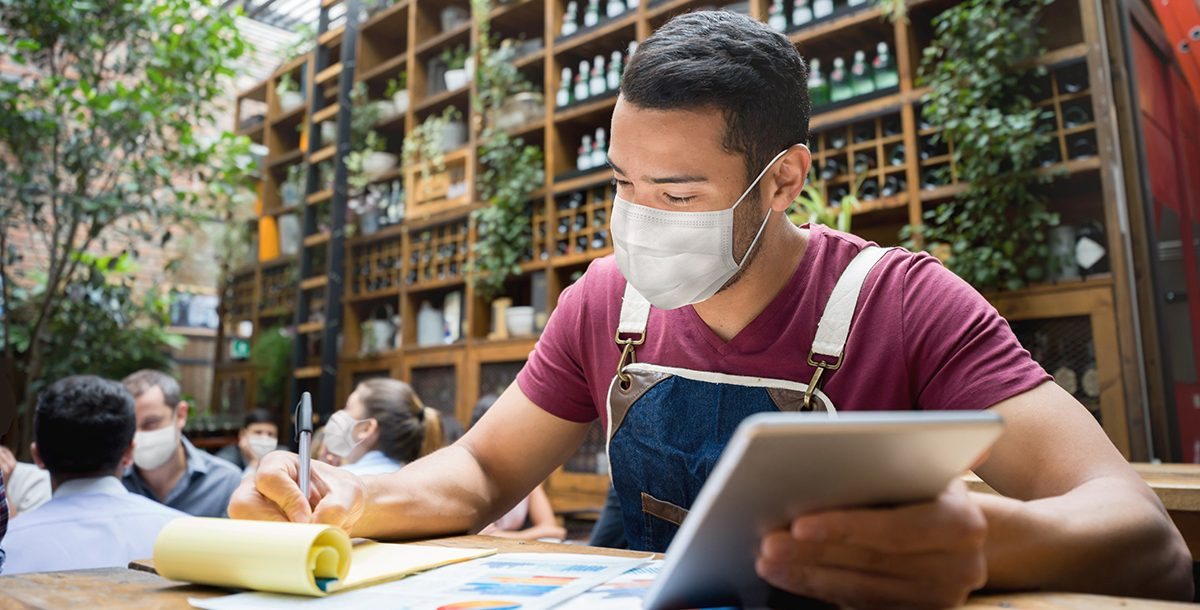 A man wearing a face mask in public.
