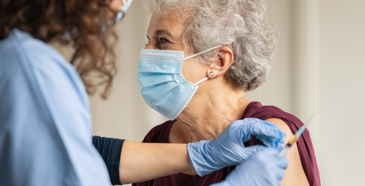 An older woman receiving her COVID-19 vaccine.