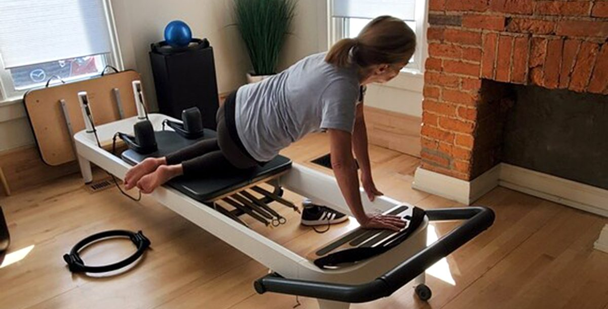 Charlotte Keller stretching at home.