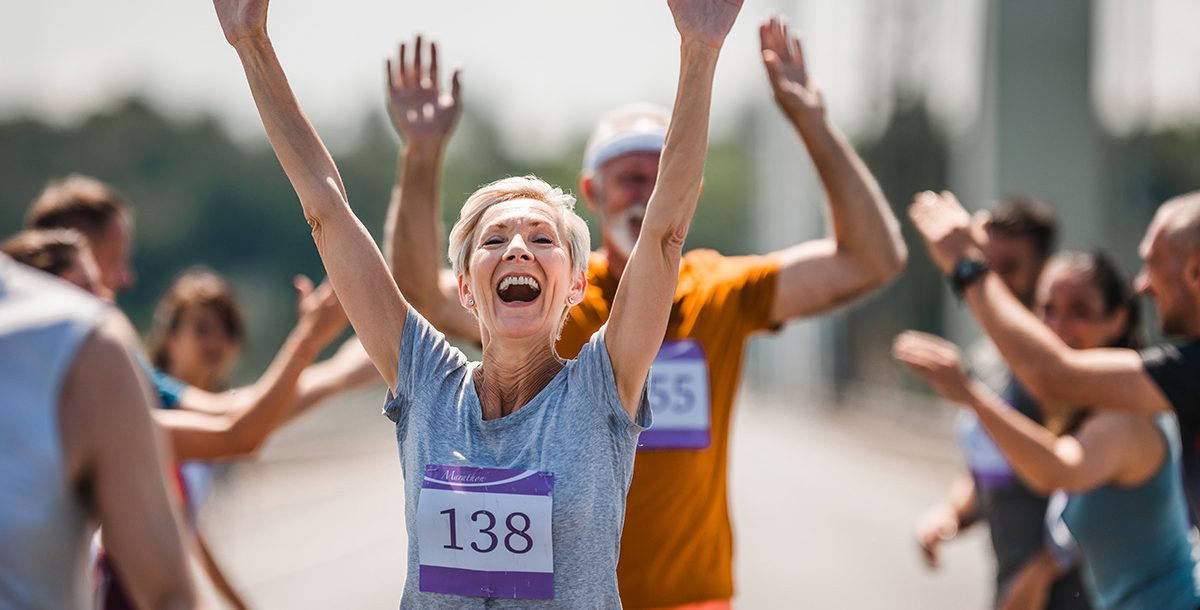 A woman crossing the finish line of a race.