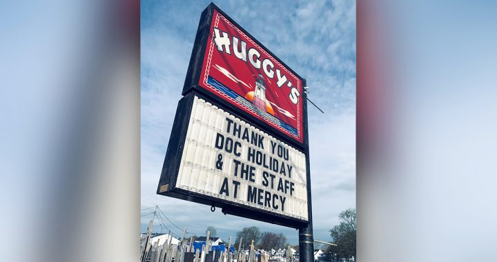 The Huggy's Social House sign