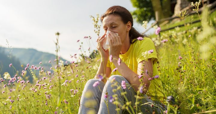 A woman experiencing spring allergies