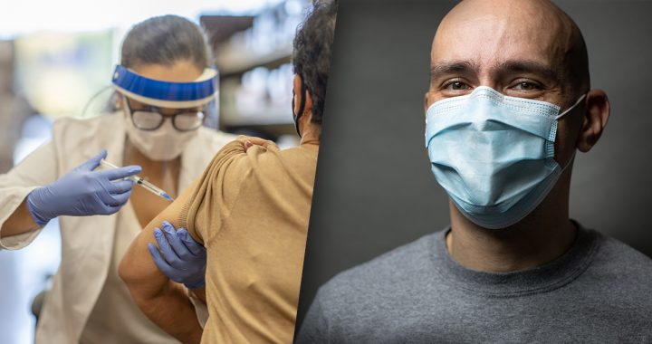 A person getting their COVID-19 vaccine and wearing a face mask.