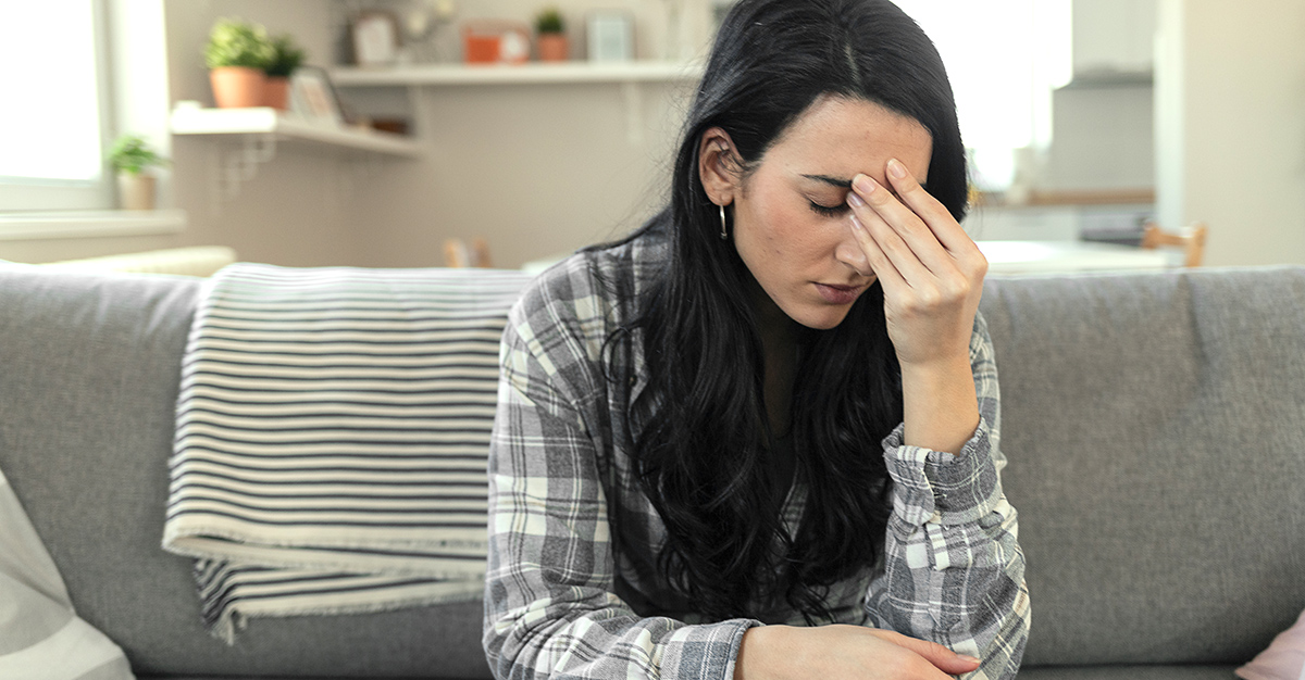 A woman experiencing COVID-19 vaccine side effects.
