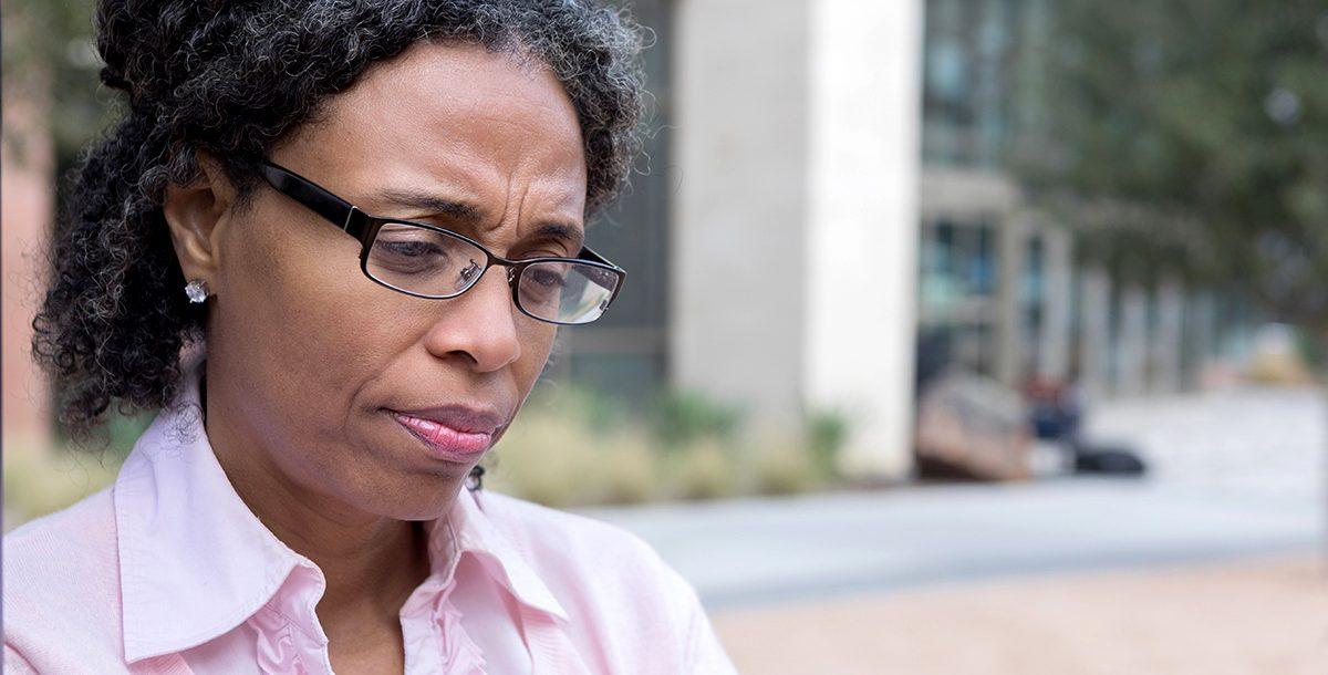 A woman experiencing post-COVID stress symptoms.
