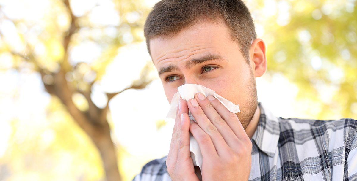 A man experiencing seasonal allergies.
