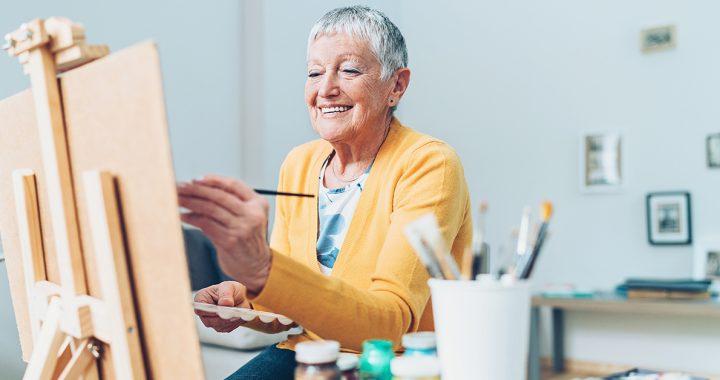 A woman enjoying painting.