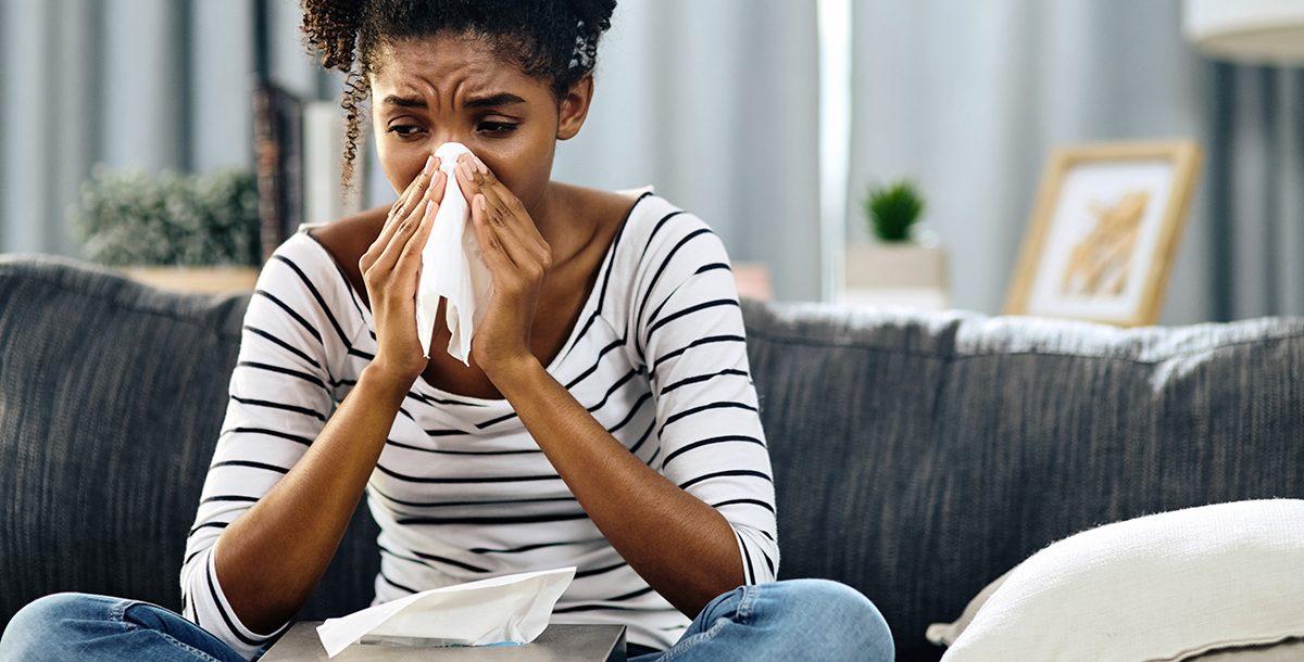 A woman experiencing hay fever symptoms.