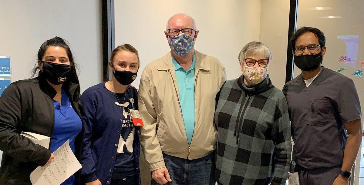 Bob Hawker with his care team.