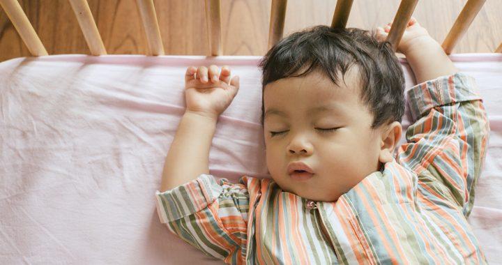 A baby sleeping in a crib.