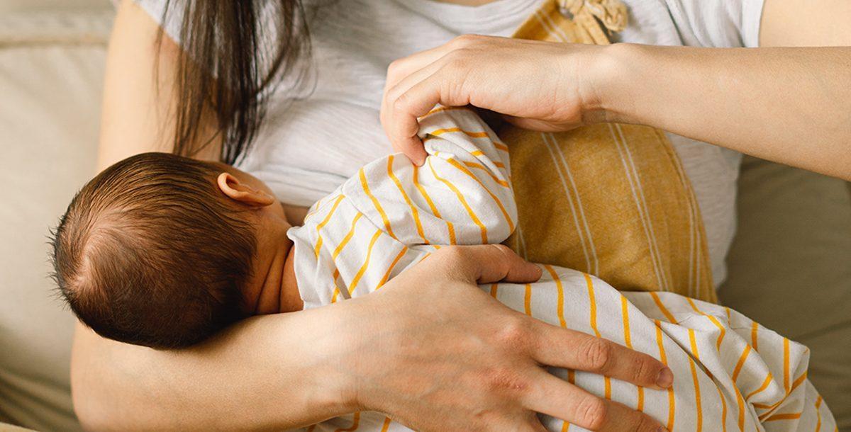 A new mom breastfeeding her child
