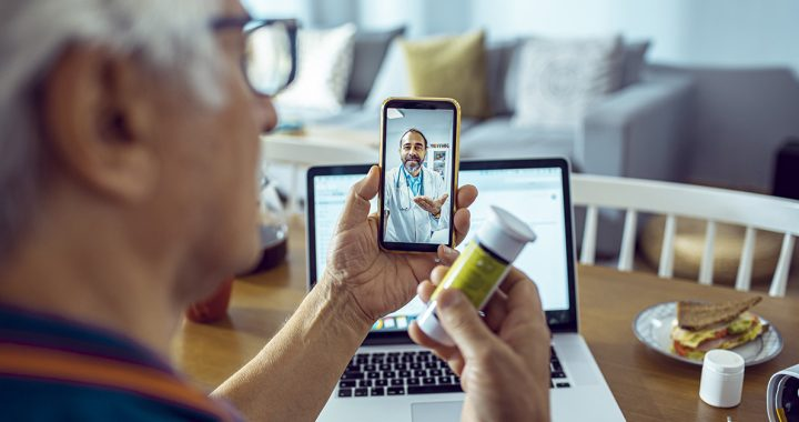A person participating in a video visit with their primary care provider.