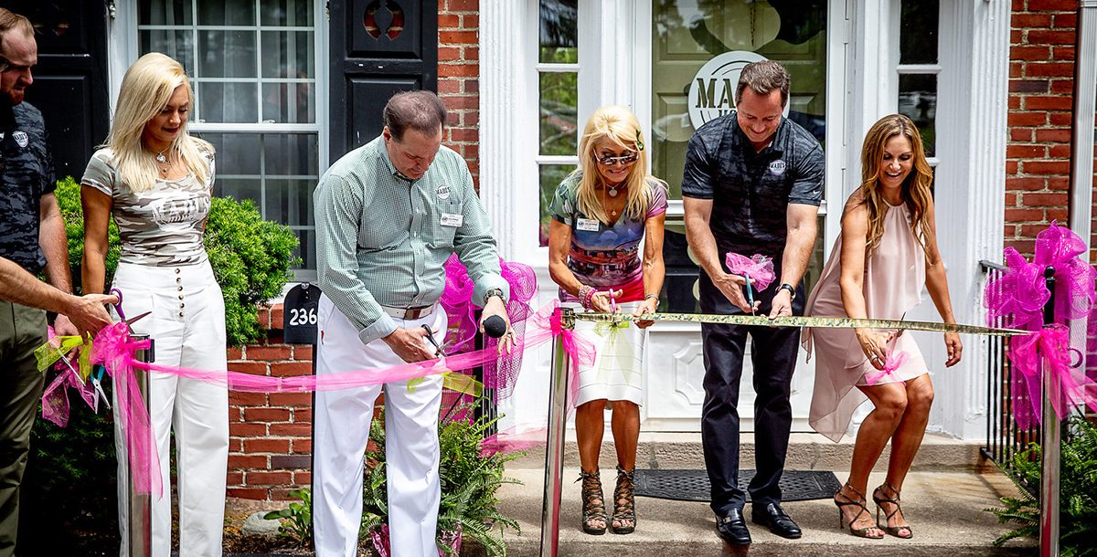 John Starcher and the Raleighs at the ribbon cutting ceremony for Madi's House.