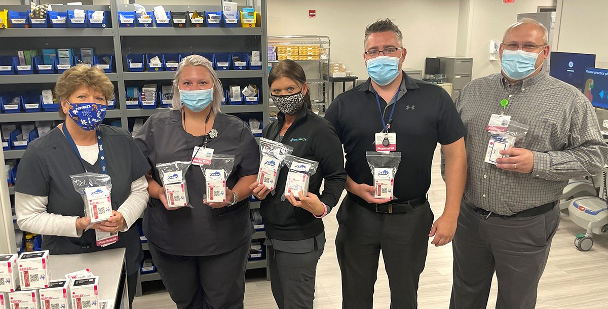 Lourdes Hospital team members with Narcan packets
